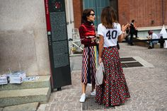 Street Style, two friends wearing multicolored, printed maxi and midi skirts: Milan Fashion Week Spring 2017 | coveteur.com