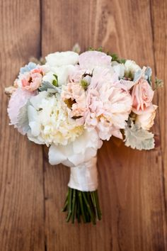 white, blush, ruffly blooms with lamb's ear or dusty miller