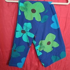 LuLaRoe TC Leggings Blue Floral LuLaRoe TC Leggings. Blue Floral. Navy blue background. Teal, light olive green, turquoise, and sea green flowers with brown centers. Navy blue used for detailing. Worn 1X, laundered per LLR instructions. LuLaRoe Pants Leggings