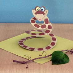 Create a Python Party Favor, a craft inspired by the movie The Jungle Book.