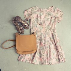 A 1950s pastel patterned cotton dress, with metallic sandals, a quartz necklace by Rhys May Jewelry, and a vintage leather bag.