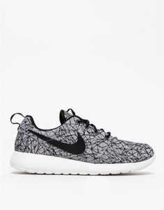 Lightweight canvas Roshe Run sneaker from Nike built with a cushioned midsole for support and comfort. Features a phylon waffle outsole for traction and durability.   •Lightweight canvas Roshe Run sneakers •Cushioned midsoles •Phylon waffle outs