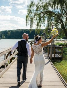 Bride and groom walking together. See more from this blue rustic wedding with simple yellow details at Tellico Village Yacht Club, photographed by Perfect Capture Photography. Flowers by Abloom Florist, formalwear by @regaltuxedoknox | The Pink Bride www.thepinkbride.com #knoxvillewedding
