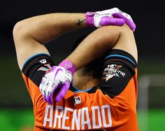 Nolan Arenado Photos Photos - A detail of the gloves of Nolan Arenado #28 of the Colorado Rockies and the National League as he stretches during batting practice for the 88th MLB All-Star Game at Marlins Park on July 11, 2017 in Miami, Florida. - 88th MLB All-Star Game