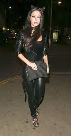 Tulisa Contostavlos was spotted at Bodo's Schloss in Kensington on October, Tulisa was wearing a black leather body hugging catsuit. She chose… Tulisa Contostavlos, Goth Beauty, Bodo, Black Suits, Female Singers, Catsuit, Black Leather, Cosplay, Celebrities