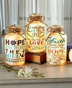 Be inspired by the words of faith on this Lighted Scripture Glass Jar. The frosted jar is embellished with a Bible verse in a decorative font with artwork accents. Lights inside the jar illuminate with a warm glow to create an eye-catching display. Crafts With Glass Jars, Wine Bottle Crafts, Jar Crafts, Bottle Art, Mason Jar Gifts, Mason Jar Diy, Glow Stick Jars, Glow Jars, Prayer Jar