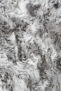 A faux fur throw for that comfy factor on your sofa! | The White Company