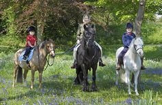 Queen Elizabeth out riding with her youngest grandchildren, Lady Louise Windsor and James, Viscount Severn.  May 2011.
