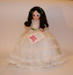 Beautiful Scarlet with green eyes and green velvet sash adorning her white lace gown and green satin ribbons in hair. No Box - Tag is on wrist. From the late 1970s - complete with shoes and undergarme