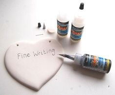 Techniques/Ways To Write on Pottery (Writing on Bisque Earthenware Ceramics). Empty writer bottle filled with glaze or underglaze.