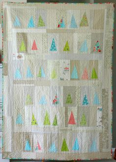 scrappy improv 'tree' quilt... Could do this for a Christmas quilt.