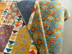 """quilt pattern is Turkish Crush by Kathy Doughty, fabric is from """"from Russia with Love (& Tractors)' by Bee & Lotus. Backing fabric is Postage Due in Toast by Anna Maria Horner (AMH) #spoonflower"""