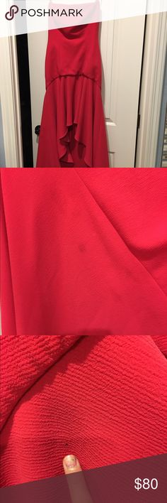 Bcbg red dress size 4 Worn once . A few stains in the back tail of dress. I don't think you can see it unless u look super close . Also a tiny hole . Gorgeous dress . BCBG Dresses High Low
