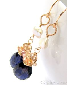 Iolite is known as water sapphire as well, due to its inky-blue color, yet I feel the very deep blue in this gem can look like the cloak of midnight, with the glistening imperial topaz as the stars that illuminate it. :-)