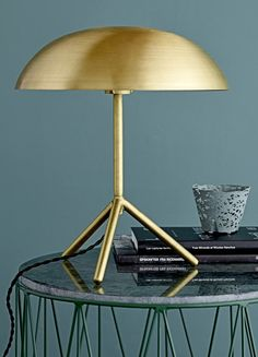 Add contemporary wow factor to your interior with this tripod table lamp from Bloomingville. With a smooth dome shaped shade, this wonderfully modern lamp features a brushed gold finish. The tripod ba Tripod Table Lamp, Metal Table Lamps, Desk Lamp, Contemporary Table Lamps, Gold Table, Interior Design Tips, Mid Century Interior Design, Luxury Furniture, Decoration