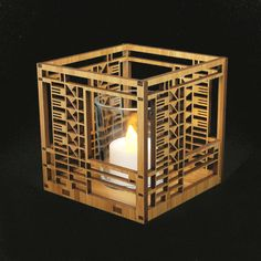 This beautiful new Frank Lloyd Wright Bach House design hardwood votive is precision laser cut for quality of finish and design accuracy. The design is adapted from an art glass window originally found in the Emil Bach House (Chicago, IL, 1915). It includes a glass votive holder and flameless tea light.