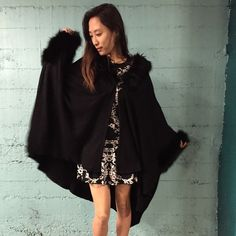 new year sale 50%offFur trimmed Poncho Not real fur but very very warm ! Nice faux fur. Not nasty Gal but they sell something similar. Trades to $100. Worn 1x. Sale from $75 Nasty Gal Sweaters