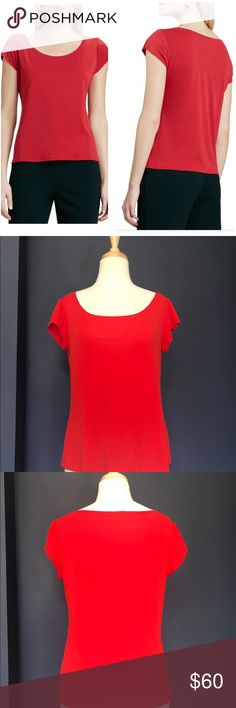 """Eileen Fisher red silk top Eileen Fisher 100% silk cap-sleeve jersey top. Color is a red-orange. The sunlight in my office makes it look neon in pics😄 I took a photo with my kate spade agenda in """"rooster red"""" as a reference b/c it's pretty much same color. Worn once, in excellent condition. One slight discolored spot down near the hem. Basically have to shine light to see (pic 7).  Dry clean. Smoke/pet-free home. Bundle or make offer! Eileen Fisher Tops Tees - Short Sleeve"""