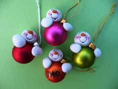 "Personalized Clay Snowman Bulb Christmas Ornaments... this is a ""for sale"" creation on Etsy. I just want to remember this for some family holiday ideas."