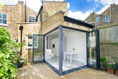 Rear Kitchen Extension and Side Infill Extension on a Victorian Terraced House in Battersea, SW6, London, Corner Opening, Bi-fold doors, Flat Roof with Skylights, Large Skylights, Kitchen Tile Design, Open Plan Design, White Kitchen, Kitchen Floor Tile Ideas, Kitchen Floor Tile Patterns, Statement Floor Tiles, Bright Open Plan Living, Small Kitchen Ideas, Patio Deck Ideas, Contemporary Extension
