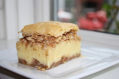 Bougatsa<3 This is my husband's favorite dessert. It is a lesser known cousin of the well known favorite baklava. My husband loves it for the rich and creamy custard that is not too sweet. It is enclosed in a blanket of crispy and buttery filo and two layers of sweet and crunchy walnuts and cinnamon.  Beautiful dessert, and very unique. Something special and sweet for your next big dinner.  Bougatsa