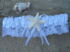 Lovely starfish embellished white satin and lace garter is lined with a soft non-slip material. Stretchability is 22 inch diameter and a
