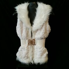 Faux leather and fur vest 100% VEGAN FUR  100% Polyester. ..shell and lining  True to size  COLOR  IS OFF WHITE Celsius Jackets & Coats Vests
