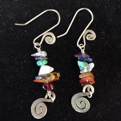 Our best seller! Our #chakra #rainbow #spiral #earrings compliment every #outfit and #mood. #fun #cute #dangles #handmade #handmadejewelry #chakrastones #chakrajewelry #yoga #energia #energy #hechoamano #mexican #american #boho #bohemian #hippiestyle #hippie #love #yogi #meditation #yogateacher #floweroflifeartesania #artesania #women Chakra Jewelry, Mexican American, Chakra Stones, Flower Of Life, Hippie Style, Spiral, Compliments, Dangle Earrings, Dangles