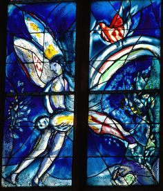 Above: Marc Chagall stained glass window, St. Stephan in Mainz, Germany . Azure and Gold April had covered the hillsWith flickering yellows and reds,The sparkle and coolness of snowWas blown from the mountain beds. Across a deep-sunken streamThe pink of blossoming trees,And from windless applebloomsThe humming of many bees. The air was of rose and goldArabesqued with the song of birdsWho, swinging unseen under leaves,Made music more eager than words. Of a sudden, aslant the road,A…