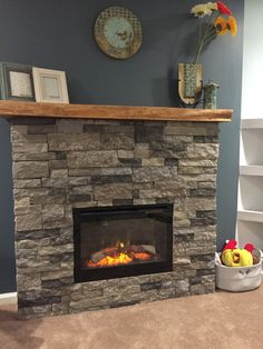So much fun!! DIY airstone electric fireplace, ambroise maple mantle, and the beautiful clock from Ugone and Thomas. Lovin' how it all came together!