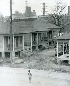 "From the Jan. 27, 1957 Houston Post: ""In the same immediate area as the Susan V. Clayton Homes is one of Houston's run down, low rental districts. This photo was taken near the 600 block of Raines Street. Slum clearance programs by the Houston Housing Authority are aimed at these neighborhoods."""