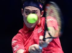 Kei Nishikori of Japan plays a backhand during his Men's Singles match against Andy Murray of Great Britain during day four of the Barclays ATP World...
