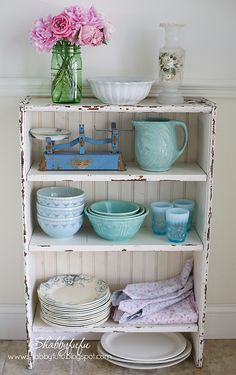 love the idea of showing off the blue and white dishes with open shelving.. either a stand alone like this or opening up some cabinets