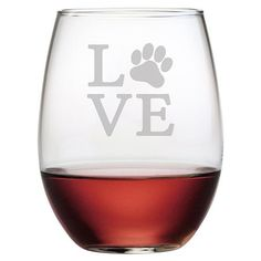 Raise a toast to your favorite furry friend with this charming wine glass, showcasing sand-etched typography and a paw print.   Prod...