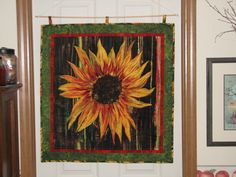 Wall hanging that I quilted myself.  I cross-hatched the center of the sunflower to give it some detail.
