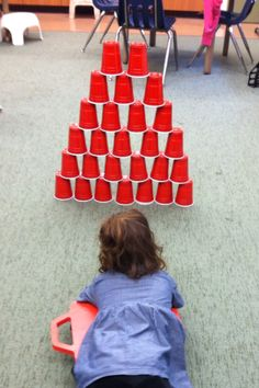 Stacking Cups - Great activity for body awareness, coordination, sensory regulation, strengthening, and visual motor skills. Gross Motor Activities, Gross Motor Skills, Sensory Activities, Therapy Activities, Preschool Activities, Summer Activities, Physical Activities, Pediatric Occupational Therapy, Pediatric Ot