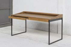 Mead Writing Desk by AELLON made of sustainably harvested teak and recycled powder coated steel.