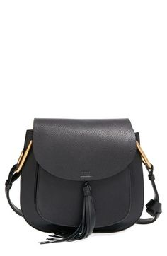 Free shipping and returns on Chloé 'Medium Hudson' Crossbody Bag at Nordstrom.com. A swishy tassel adds a touch of '70s flair to a structured crossbody bag in a minimalist, equestrian-inspired silhouette. Polished goldtone hardware and lavishly textured leather extend the Italian refinement of the must-have style.