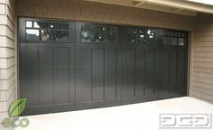 If you can dream it, our craftsmen can build it. Garage door crafting has come a long way. Traditional design combined with a little bit of creativity can prove to be a sensational outcome. With its dark paint and craftsman style window panes this custom wood garage door was the best curve appeal improvement this home could get.
