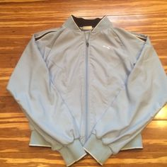 Vintage Puma light weight zipper jacket Vintage Puma jacket with full front zipper.  Size small (would also work for XS).  Light blue with darker blue stripes down both sleeves.  Two front pockets.  In very good pre owned condition. Puma Jackets & Coats