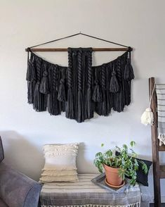 This is a MADE TO ORDER hanging. Please allow approximately 4 weeks for completion.   This hanging is full of twists, macramé, tassels and braids. It would look great above a bed or sofa.  MATERIALS: Acrylic/wool yarns, rustic stained wooden dowel, black cotton hanging cord.  COLOR: charcoal/dark Large Macrame Wall Hanging, Yarn Wall Hanging, Wall Hangings, Acrylic Wool, Large Wall Art, Wool Yarn, Wooden Beads, Black Cotton, Color Combinations