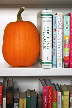 A pumpkin for a bookend at Halloween. Cute.