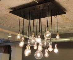OMG would love this for the dining area! Industrial Chandelier with vintage bulbs by urbanchandy on Etsy, $595.00