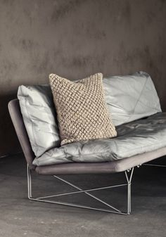 love the silvery silk cushions on this stylish modern sofa with thin metal legs