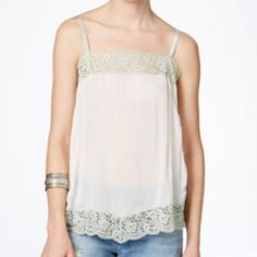 Free People Camisole or Tank Top Free People camisole or Tank top. Lace, scalloped neck. Beautiful lace trim! - Sleeveless - Grosgrain ribbon straps - Split side seams - Scalloped hem Free People Tops Camisoles