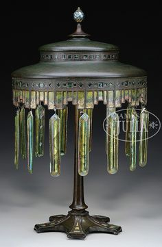 Tiffany Furnaces lamp has heavy bronze shade with an irregular border made up of bronze geometric panels. Each panel is enameled with splashes of green, brown and orange. Stepped shade is further decorated on the sides with squares and diamonds done. Antique Lamps, Antique Lighting, Vintage Lamps, Vintage Clocks, Tiffany Art, Tiffany Glass, Art Nouveau, Art Deco, Large Lamps