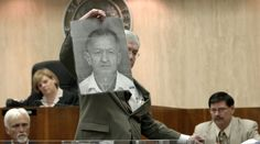 The Jinx Chapter 4 | Defense attorney Mike Ramsey holds up a photograph of Morris Black for the jury in New York real estate heir Robert Durst's trial Monday, Sept. 29, 2003, in Galveston, Texas. Durst is accused of killing Black, a 71-year-old neighbor at a low-rent Galveston apartment house where both men lived, then dismembering the body and throwing the parts into Galveston Bay two years ago.