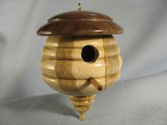Hi, thanks for looking in. The one-of-a-kind, handcrafted ornament you are viewing, was turned from Maple and Walnut wood. The finish is 4 coats