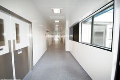Polarex Hygienic PVC Wall Cladding in Satin White installed in a hospital corridor. Pvc Wall Panels, Ceiling Panels, Cladding Sheets, Steel Cladding, Ceiling Cladding, Welding Rods, Shower Panels, Wet Rooms, Business Inspiration