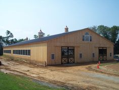 build facing east west with barn to the north and breezeway to arena... park horse trailers along far wall for storage